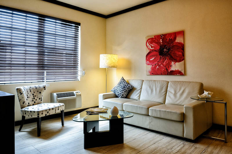 Tradewinds Apartment Hotel. One Bedroom Apartment Suites. Living Room